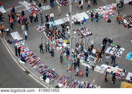 Barcelona, Spain - October 26, 2015: Immigrants Sell Counterfeit Goods, Fake Products In The Streets