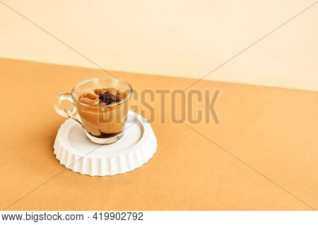 Traditional Italian Dessert Coffee Cream In A Glass Cup On Beige Background. National Cuisine Recipe