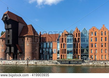 Gdansk, Poland - Sept 9, 2020: Old Town Of Gdansk With The Medieval Port Crane  And A Promenade Alon