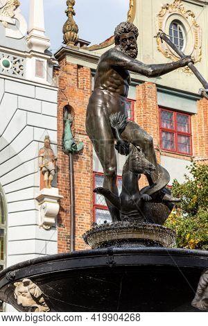 Neptune Fountain At Long Market Street In Gdansk. Poland