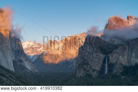 Winter Sunset Shot Of Snow On Yosemites Half Dome As Storm Clouds Clear From Yosemite National Park