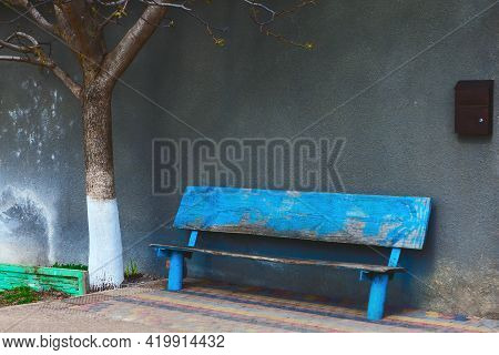 Wooden Bench And Mailbox In Village . No One Is At The Address