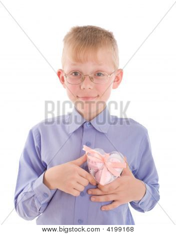 Portrait Of Smiling Young Boy Gving Gift