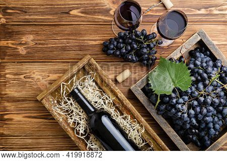 Red Wine Composition On Brown Wooden Table. Top View. Red Wine Bottle Corkscrew Corks Wine Glasses B