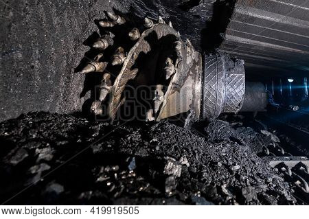 Shearer Drill Head In A Coal Mine. Extraction Of Coal By Underground Method.