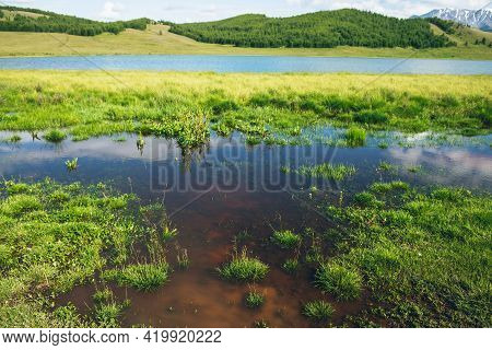 Scenic Layered Landscape With Two Mountain Lakes And Green Grasses. Vivid Alpine Scenery With Beauti