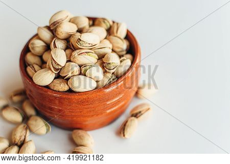 Pile Of Pistachios In The Bowl. Healthy Vegetarian Protein Nutritious Food. Vegetarian Food Concept.