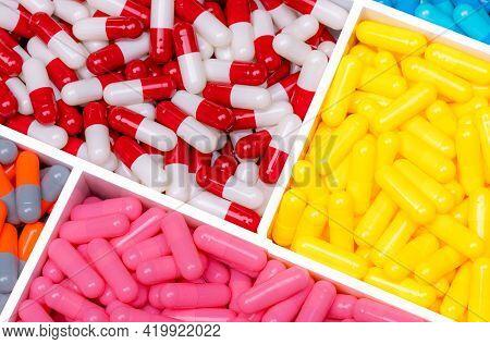 Top View Multi-colored Antibiotic Capsule Pill In Tray. Antibiotic Drug Resistance. Antimicrobial Ca