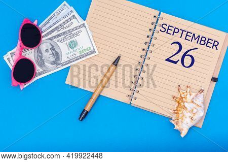 26th Day Of September. Travel Concept Flat Lay - Notepad With The Date Of 26 September Pen, Glasses,