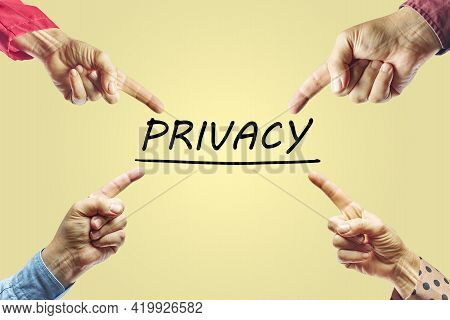 Hands Of People Pointing To The Word Privacy. Privacy Concept