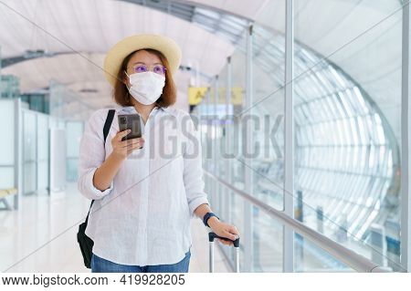 New Normal Tourist Wearing Face Mask Is Traveling On The Airport , New Lifestyle Travel After Covid-