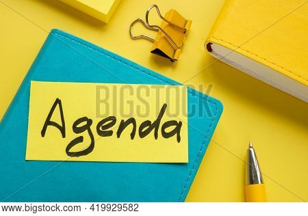 Piece Of Paper With Word Agenda And Notepads.