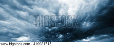 Dramatic thunderstorm clouds background. Dramatic dark storm clouds