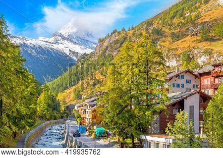 Zermatt, Switzerland Street View In Famous Swiss Alps Ski Resort, River, Snow Matterhorn