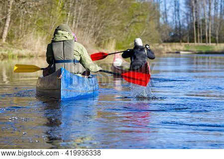 Family Canoeing On The River In The Early Morning. Joint Pastime, Entertainment, Outdoor Recreation,