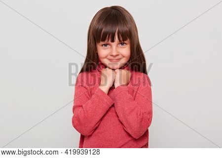 Cute Little Girl Wearing Red Casual Style Sweater Looking Directly At Camera With Happy Shy Smile, K