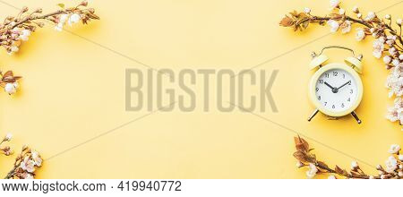 Springtime Background. Spring Border, Blossom And April Floral Nature With Alarm Clock On Yellow. Br
