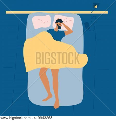 Man Sleep In Bed At Night. Top View.  Sleeping Man. Healthy Lifestyle Concept Of Relax Calm Tired Bo