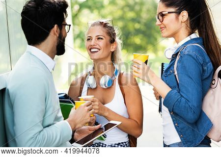 Group Of Happy University Students Studying Together And Having Fun Outdoors