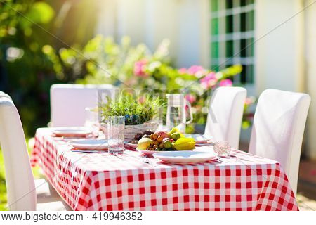 Summer Lunch Outdoors. Table Setting For Barbecue Party. Garden Fun. Bbq In Sunny Backyard. Party De