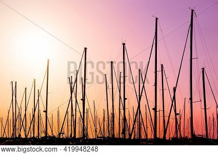 Shipyard At Colorful Sunset With Boats In The Harbor.