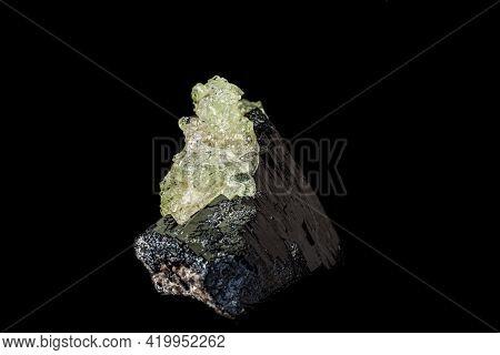 Macro Stone Hyalite Mineral, Tourmaline Sherl, Smoky Quartz On A Black Background Close-up