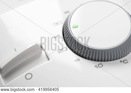 Digital Climate Thermostat Control. White Thermostat Isolated On White Background. Thermostat Climat