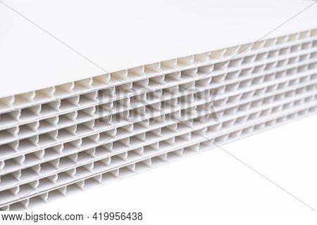 Construction Vinyl Siding Panels Pattern. House Covered With White Plastic Vinyl Siding. Vinyl Sidin
