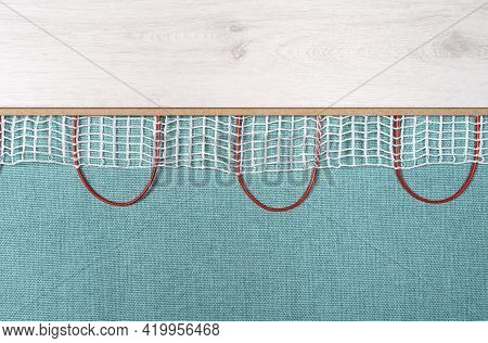Heated Floor Under Laminate Background. Underfloor Electric Heating. Warm Floor System Texture. Mat