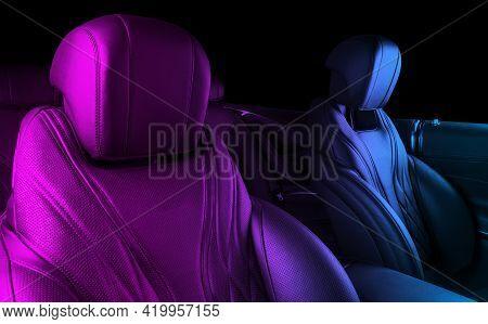 Modern Luxury Car Inside. Interior Of Prestige Modern Car In Blue And Pink Tones. Comfortable Leathe