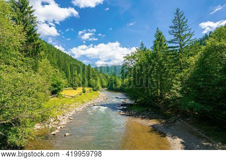 River In The Valley Of Carpathian Mountains. Beautiful Countryside Scenery. Rural Fields On The Shor