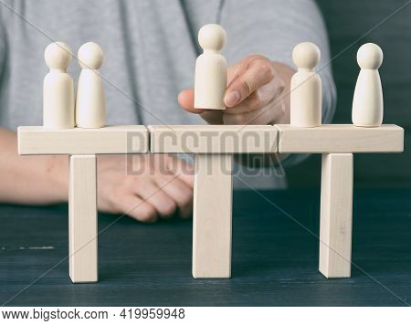 Little Wooden Men Stand On The Destroyed Bridge On Different Sides On A Blue Background Negotiator B