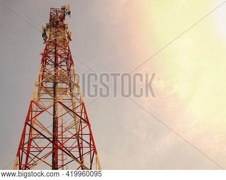 Telephone Towers Used To Broadcast Signals At Dusk.