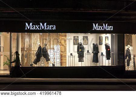 Belgrade, Serbia - December 3, 2020: Max Mara Logo On Their Main Shop In Serbia At Night. Maxmara Ma