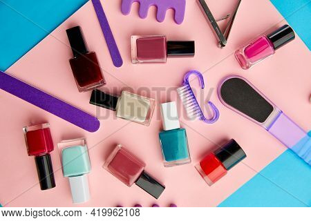 Nail care products, polish on pink background