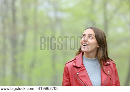 Amazed Woman In Red Contemplating Walking In A Forest