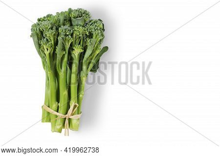 Green Sprouting Broccoli Or Green Baby Broccoli On White Background With Clipping Path. Top View.