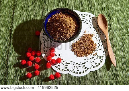 Loose Instant Coffee In Blue Beautiful Ceramic Saucer And A Small Wooden Spoon. A Resource For Makin