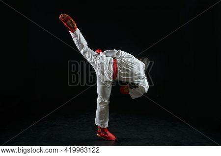 Karateka, fighter in white kimono and red gloves