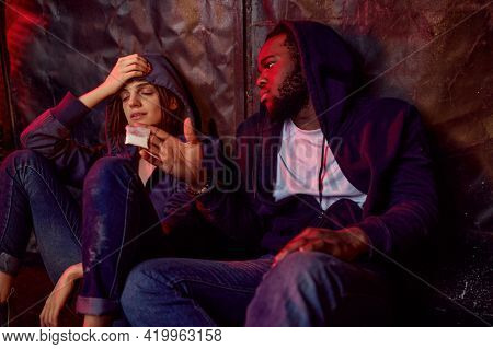 Drug addict man and woman under high in den