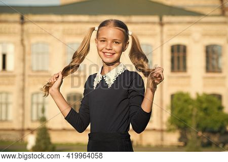 My Hair Needs A Hairdresser. Little Girl In Pigtails Outdoors. Happy Child Hold Long Blond Hair. Hai