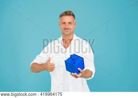 Giving You A Best Gift. Happy Man Give Thumbs Up Holding Gift. Gift Or Present Box. Holiday Preparat