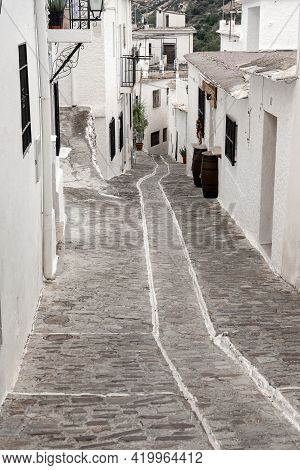 Pampaneria, Granada - September 01, 2020: View Of The White Streets Of The Village Of Pampaneira In