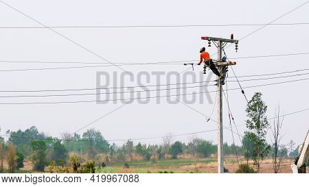 Kamphaeng Phet, Thailand - April 2, 2020 : Electrician Doing Repairing And Maintenance Of The Wires