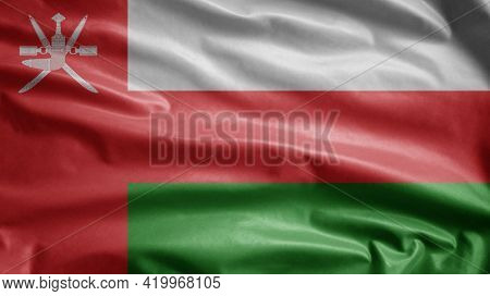 Omani Flag Waving In The Wind. Oman Banner Blowing Soft Silk.