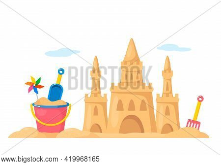 Sand Castle With Baby Bucket And Shovel On The Beach. The Concept Of Vacation And Travel With Childr