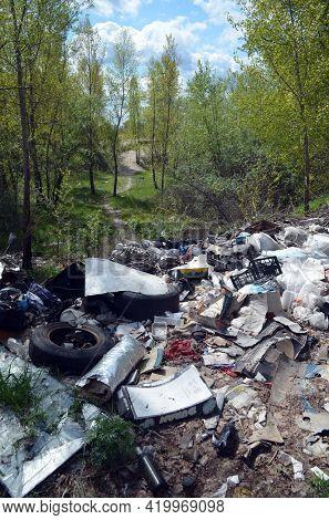 Spring landscape.Ecology of Ukraine. Nature near Ukrainian capital. Environmental contamination. Illegal junk dump.May 9,2021. Kiev , Ukraine