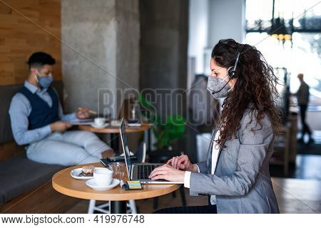 Business People With Laptop Working In Cafe, Small Business, Coronavirus And New Normal Concept.