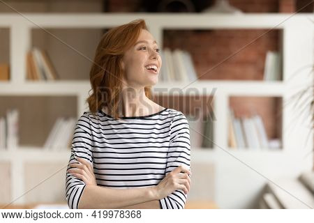 Head Shot Smiling Dreamy Motivated Businesswoman Looking To Aside