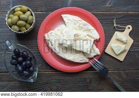 Balkan Cuisine. Montenegro. Pljevaljski Cheese  - Local Soft White Cheese. Dark Rustic Table